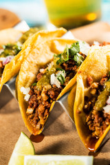 Detail of mexican tacos with beer glass.