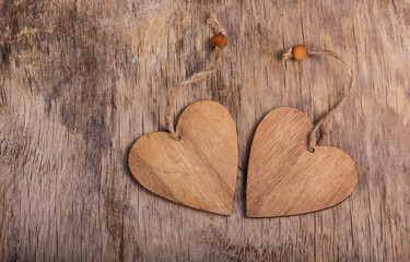 Two valentines on the old wooden background. Wooden hearts. Copy space. Valentine's day.
