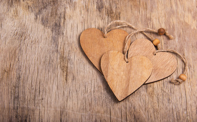 Hearts made of wood in the old worn wooden background. Wooden valentine. Valentine's day. Copy space