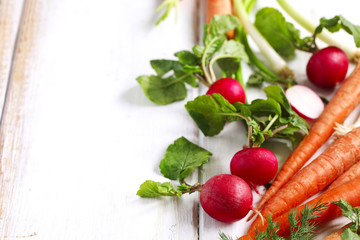 Spring vegetables on wooden background with copy space.