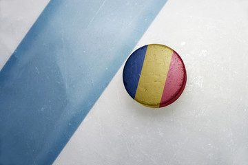 old hockey puck with the national flag of romania .