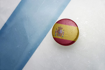 old hockey puck with the national flag of spain.