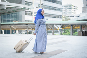 arab woman hand holding a suitcase walking to airport