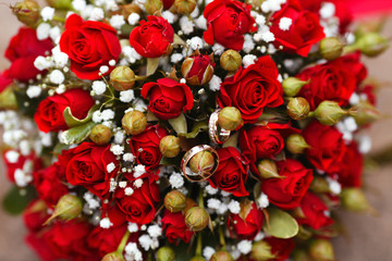 Bright juicy red wedding bouquet of small red roses