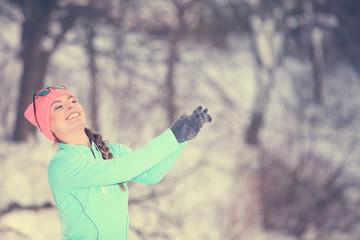 Girl having fun with snow.