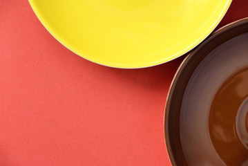 Abstraction with colorful plates on red background