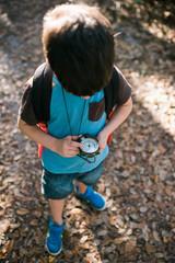 Boy holding compass