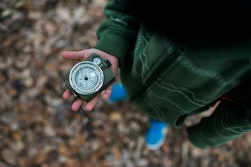 Child holding compass