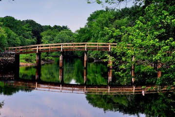 Concord, Massacusetts - Jul 12, 2013:  Historic Old North Bridge over the Sudbury River where the American Minute Men and the British Redcoats fought the second battle of the American Revolution   *