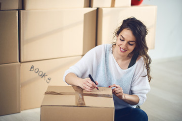Woman packing stuff for moving