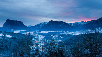 Majestic winter landscape with intensive sunset in Trentino, Ita