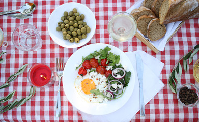 Romantic picnic. Outdoor meal with eggs, tomatoes and glass of wine. Flat lay
