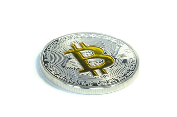 Single Bitcoin coin laying on white background