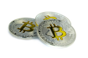 Focused Bitcoin coins laying on white background