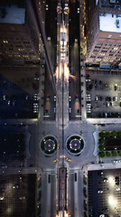 Overhead view roundabout reflected in glass fronted building