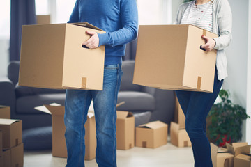 couple moving in new flat, with boxes with stuff