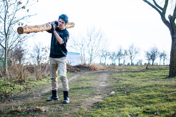 Young man and big log
