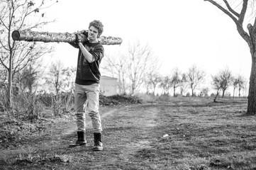 Young man and big log