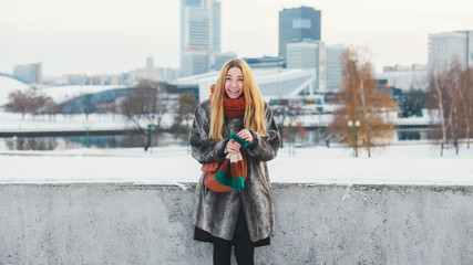 Portrait of an attractive girl outdoors in winter