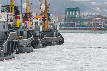 Tugboats and Ice in Port of Gdynia during winter season, Poland.