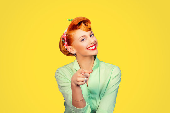 portrait of a beautiful woman pinup retro style pointing at you smiling laughing