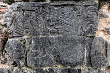 Ancient Mayan mural at the Great Ball Court in Chichen Itza depicting the ball players wearing protective clothing and decorated with feathers.