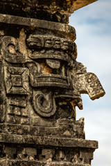 Three-dimensional mask on the edge of the Nunnery Annex building in Chichen Itza, believed to be the Ancient Mayan god of rain and lightning Chac.