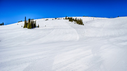 Spring Skiing at the Top of the World at Sun Peaks in the Shuswap Highlands of central British Columbia, Canada