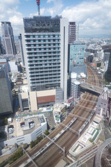 modern office building and railway track of Osaka city, Japan