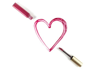 Heart drawn with lip gloss on white background