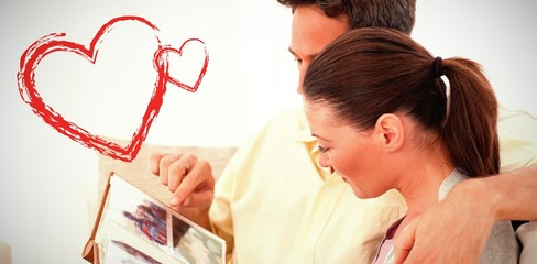 side view of lovely couple looking at pictures