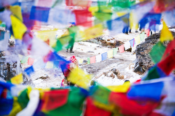 color prayer flags on top of Annapurna base camp