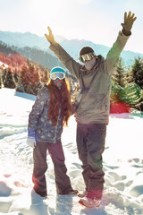 ?ouple snowboarder in place in the mountains