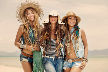 beautiful hippie girls in denim clothes outdoors