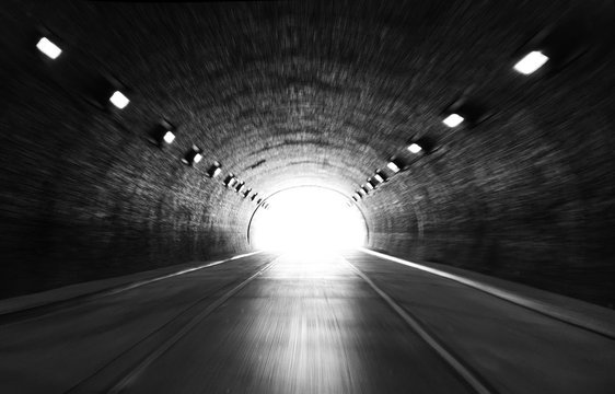 defocused photo on light at the end of tunnel