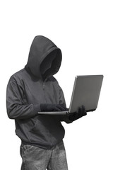 Hacker with anonymous mask with laptop while standing
