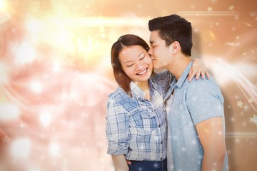 Composite image of man kissing happy woman
