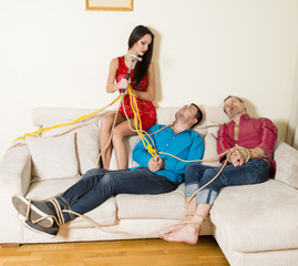The woman with the hammer and two men connected by a rope, revenge to ex-boyfriends