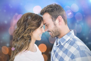 Composite image of happy young couple rubbing nose