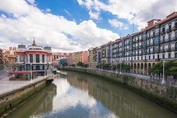 House facades in Bilbao along the Nervion river that runs through the city into the Cantabrian Sea. The apartment blocks are situated in the district San Frantzisko, on left the Mercado de la Ribera