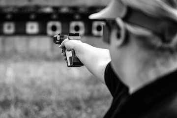 Woman on sport shooting training