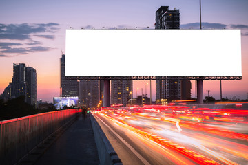 billboard in th twilight with light  of cars moving