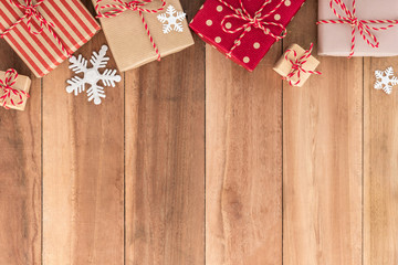Gift boxes and Christmas ornaments on wood background