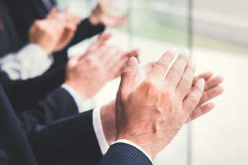 Business people clapping their hands