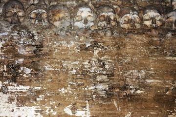 Grunge Halloween background with human skulls