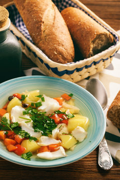 Clear fish soup with vegetables.