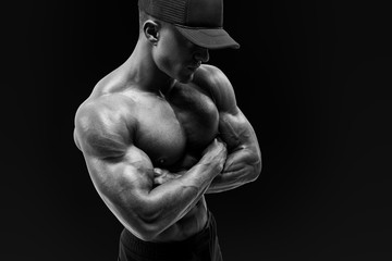 Shot of healthy muscular young man with black beseball cap