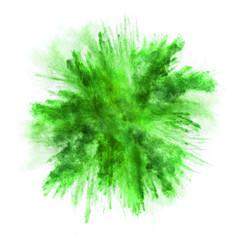 Explosion of green powder on white background