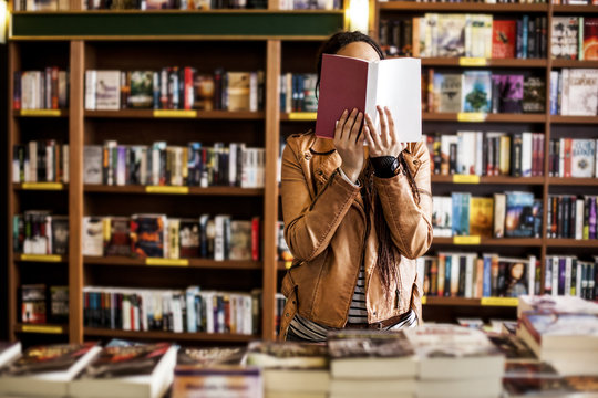 Woman Reading at a Bookstore