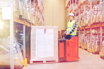 man on forklift loading boxes at warehouse